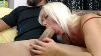 Blonde whore sucking a huge white dick on cam