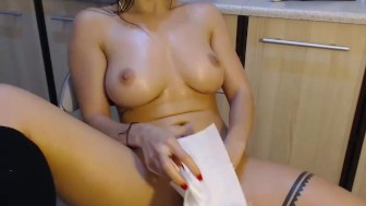 Cute girl playing with herself in the kitchen...