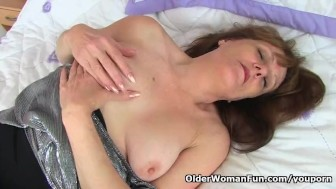 English gilf Pandora stuffs her old pussy with dildo