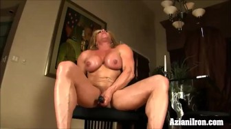 2 Fitness models one dildos the other pumps her pussy