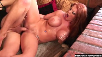 BestGonzo - Redhead Sophie Dee is kneeling to get a hard cock in her mouth.