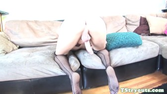 Young trans beauty rubs cock on casting couch