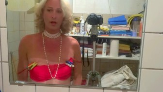 Blond KittyTranny before the mirror in red bra