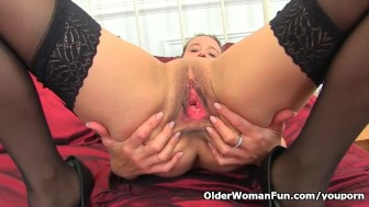 English milf Caz fingers her mature pussy