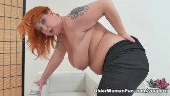 Redhead milf Alex fingers her sex holes