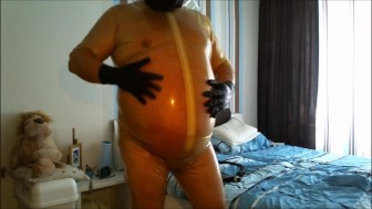 great chubby showing, wanking and jerking off in transparent latex.mp4